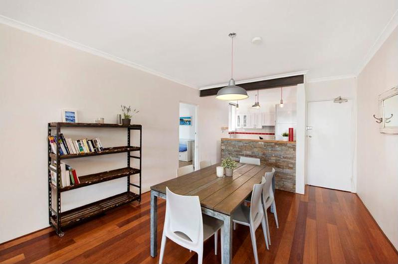 The dining and kitchen of the three bedroom apartment Rose & Jones purchased prior to auction at 101-103 Wentworth Street Randwick